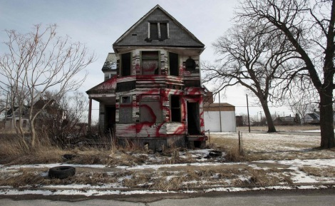 A vacant and blighted home, covered with red spray paint, sits alone in an east side neighborhood once full of homes in Detroit, Michigan January 27, 2013. The story of Detroit's decline is decades old: Its tax revenue and population have shrunk and labor costs have remained out of whack. Picture taken January 27, 2013. To match Analysis USA-DETROIT/BANKRUPTCY REUTERS/Rebecca Cook (UNITED STATES - Tags: BUSINESS EMPLOYMENT POLITICS TPX IMAGES OF THE DAY)